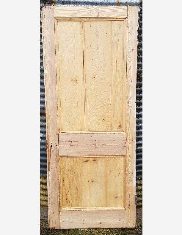 1216 - Large stripped pine antique 2 panel door 36 x 88