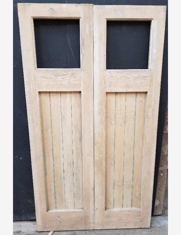 2110 - Pair of pine reclaimed framed plank doors with top light
