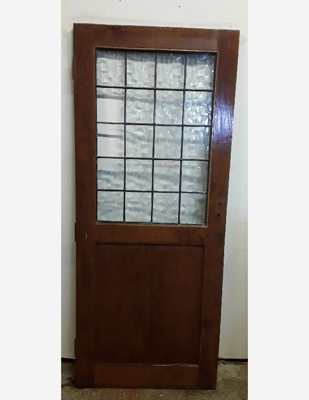2298 - Period solid oak stained door with original lead lites