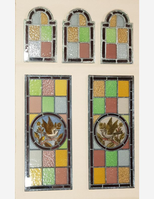 2233 - Stained glass with painted roundels - a sparrow in foliage