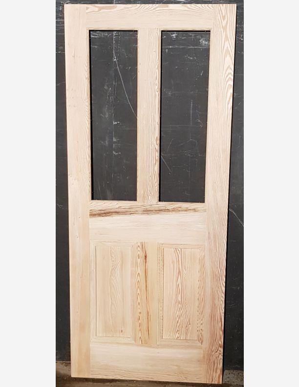 2398 - New Vintage Pitch Pine 2 over 2 unglazed door