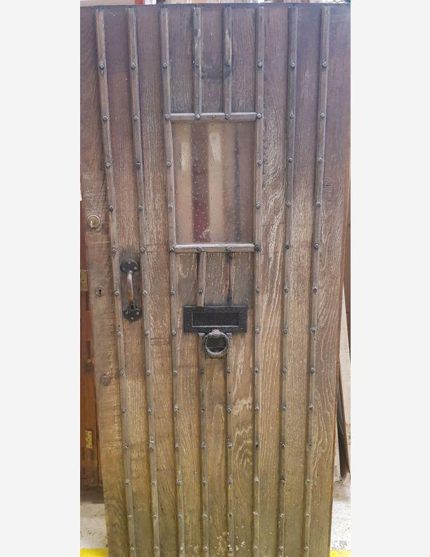 2805 - Solid oak framed brace and ledge studded front door
