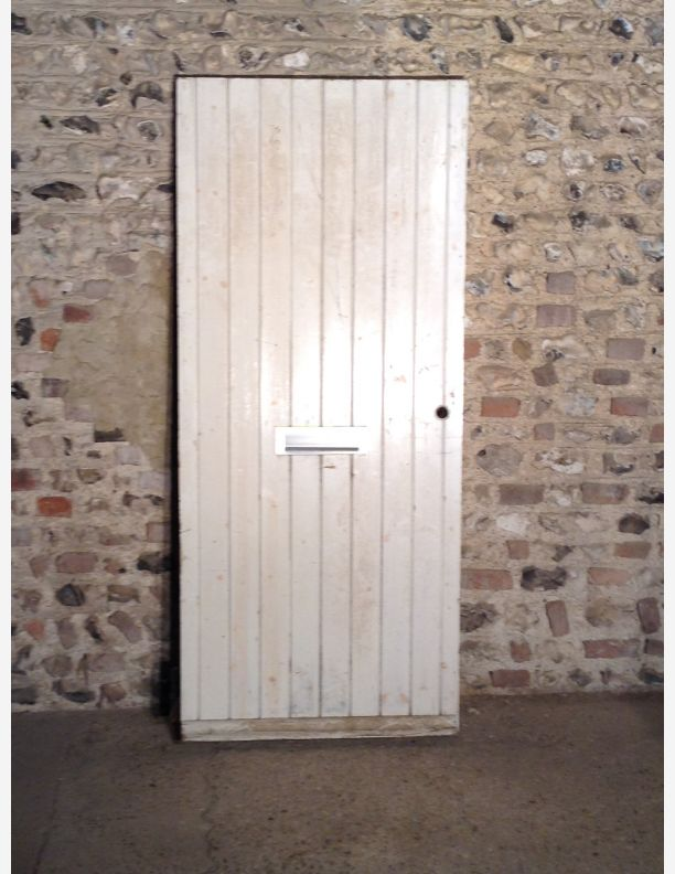 586 - A Braced and Ledged Side Door with Letterbox