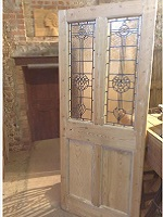 reclaimed door with hand made glass